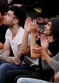 Adam sitting with Zac Efron 2