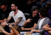 Adam sitting with Zac Efron 3
