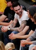 Adam sitting with Zac Efron 4