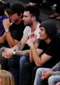 Adam sitting with Zac Efron 5