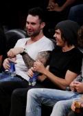Adam sitting with Zac Efron 6